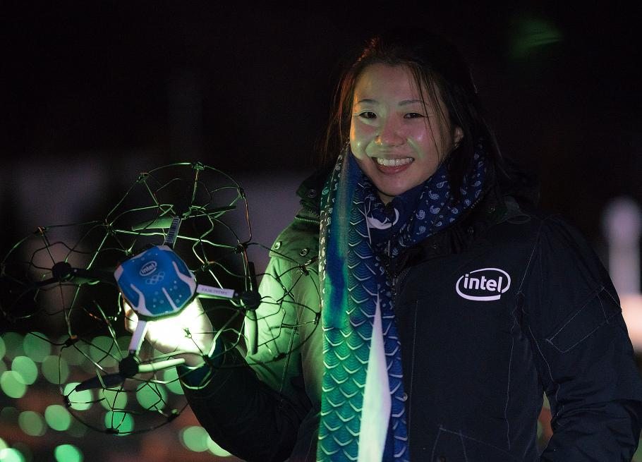 Natalie Cheung holding one of Intel Shooting Star drones used during the Winter Olympics Opening Ceremony.