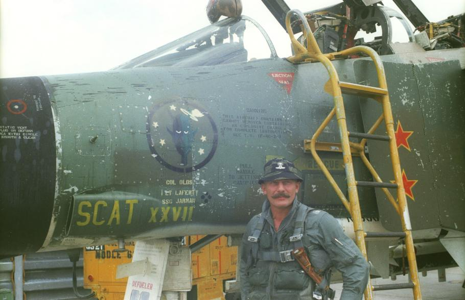 man in front of aircraft