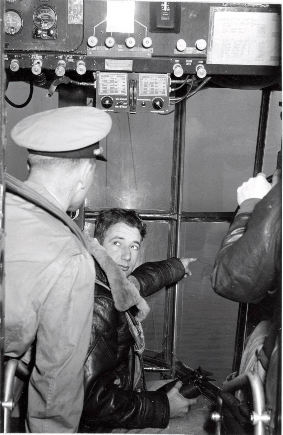 Three airmen inside K-ship cabin