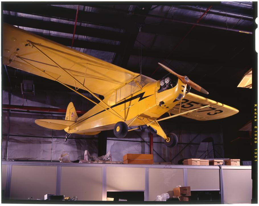 Yellow aircraft hanging