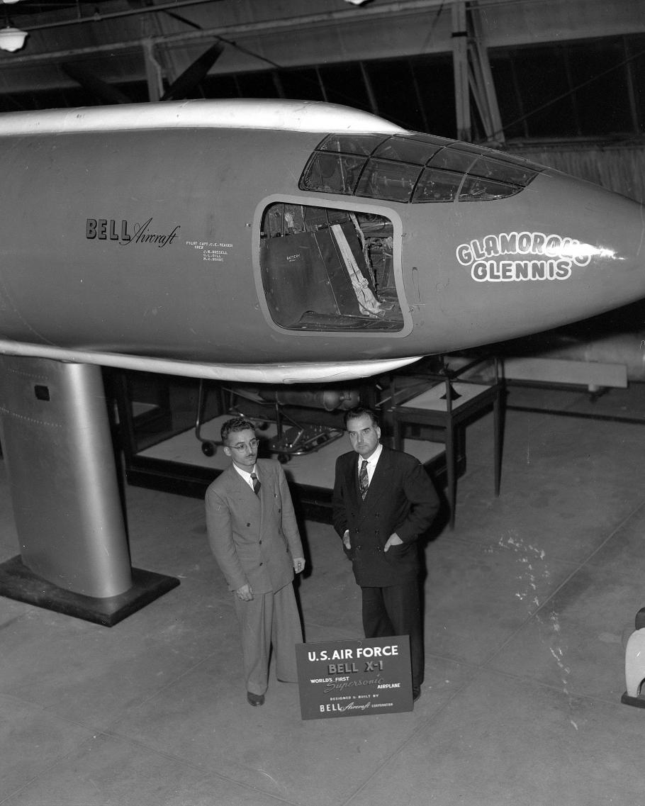 Two men in front of aircraft