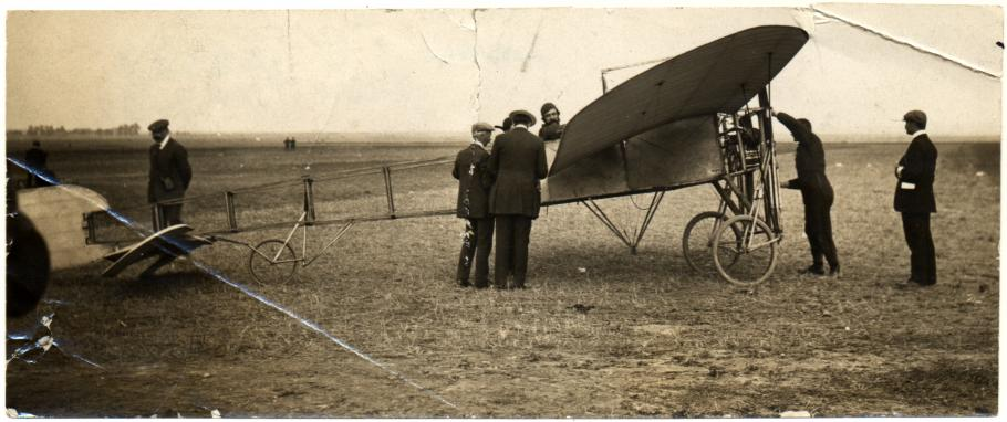 Men gathered around aircraft