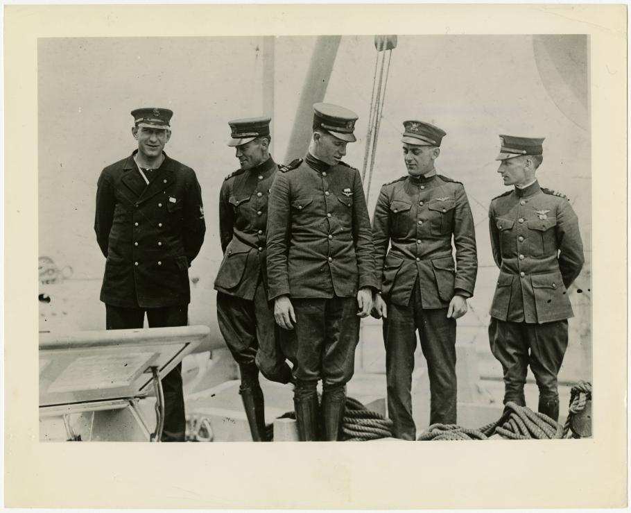 Five men in naval uniforms