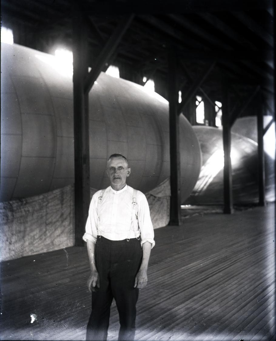 Man in front of balloon in factory