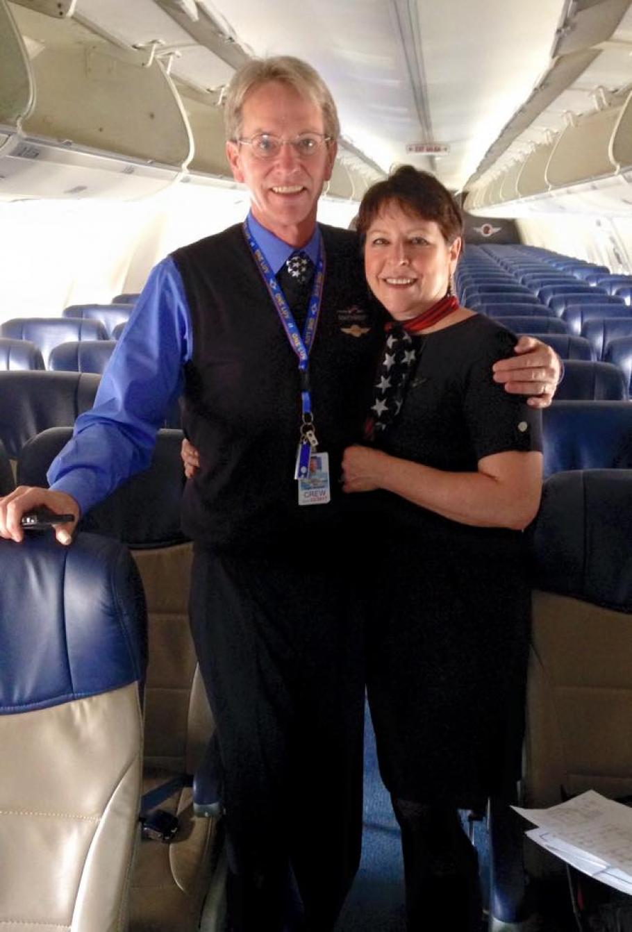 Cindy and George on his first flight as a Southwest Flight attendant.