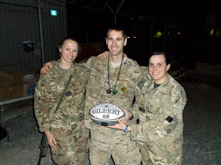 Royal Air Force Flt. Lt. Sarah Cole sharing a love of rugby with members of the United States Air Force in Afghanistan.