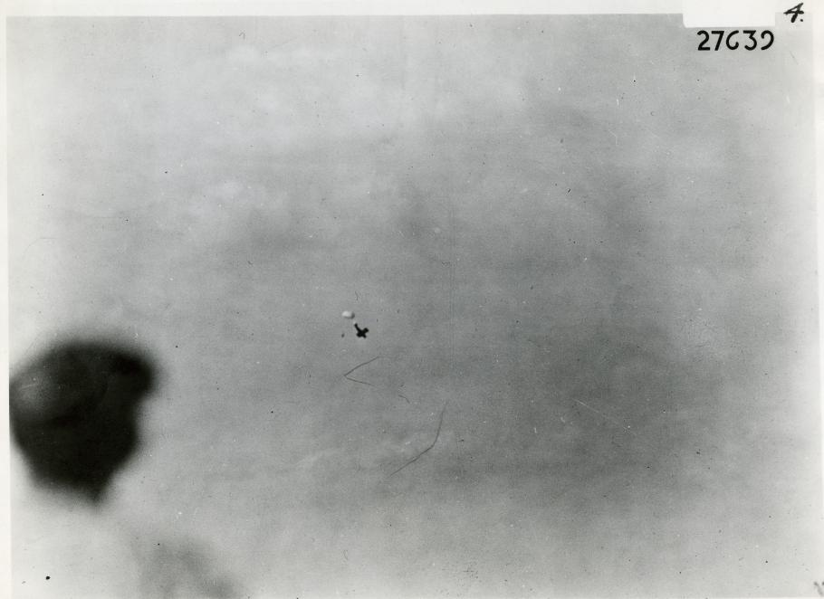 Plane in distance with parachute