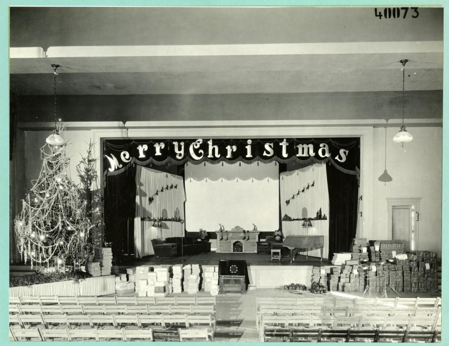 Auditorium decorated for the holidays, Christmas tree on left