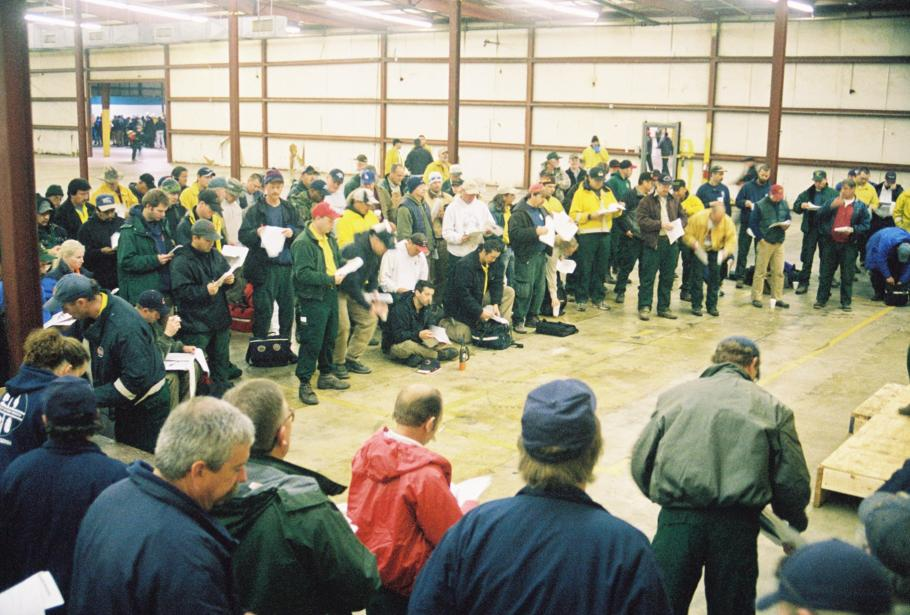 Fire crews gather for a morning briefing in a warehouse in Palestine, Texas on February 23, 2003 before venturing out to search for Columbia debris.