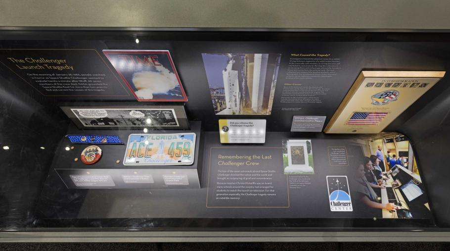 A display case in the Moving Beyond Earth exhibition, commemorating the Challenger launch tragedy.