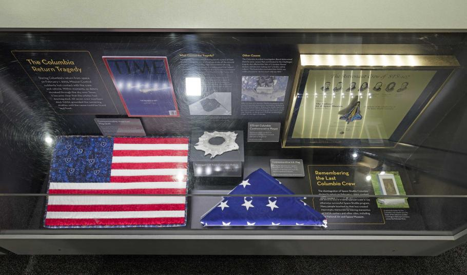 A display case in the Moving Beyond Earth exhibition, commemorating the Columbia return tragedy.