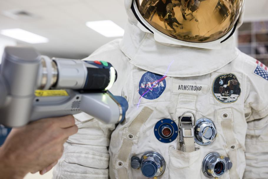 laser arm with spacesuit
