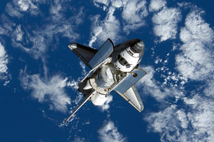 Space shuttle Discovery approaches International Space Station during STS-120 mission.