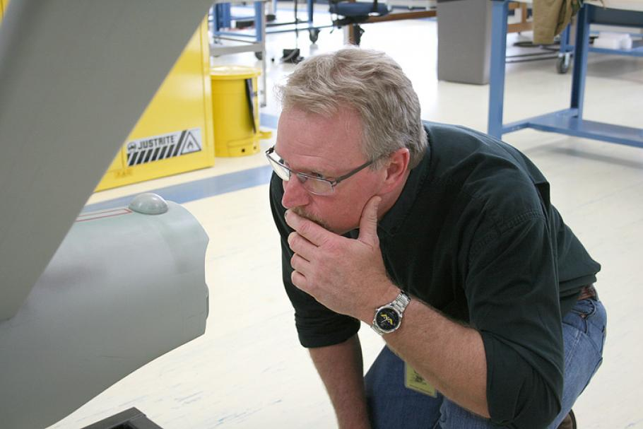 ILM model maker John Goodson studies the hangar deck at the back of the ship's engineering hull.