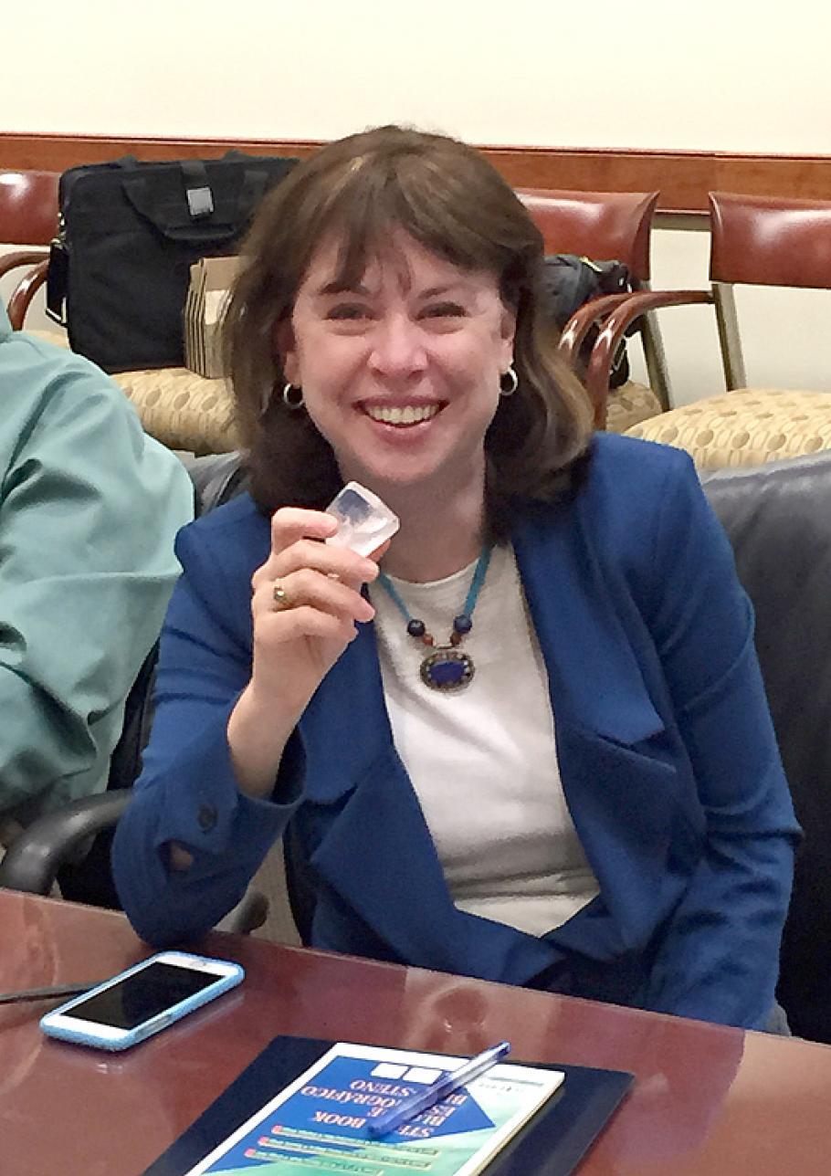 Dr. Margaret Weitekamp holding a dilithium crystal