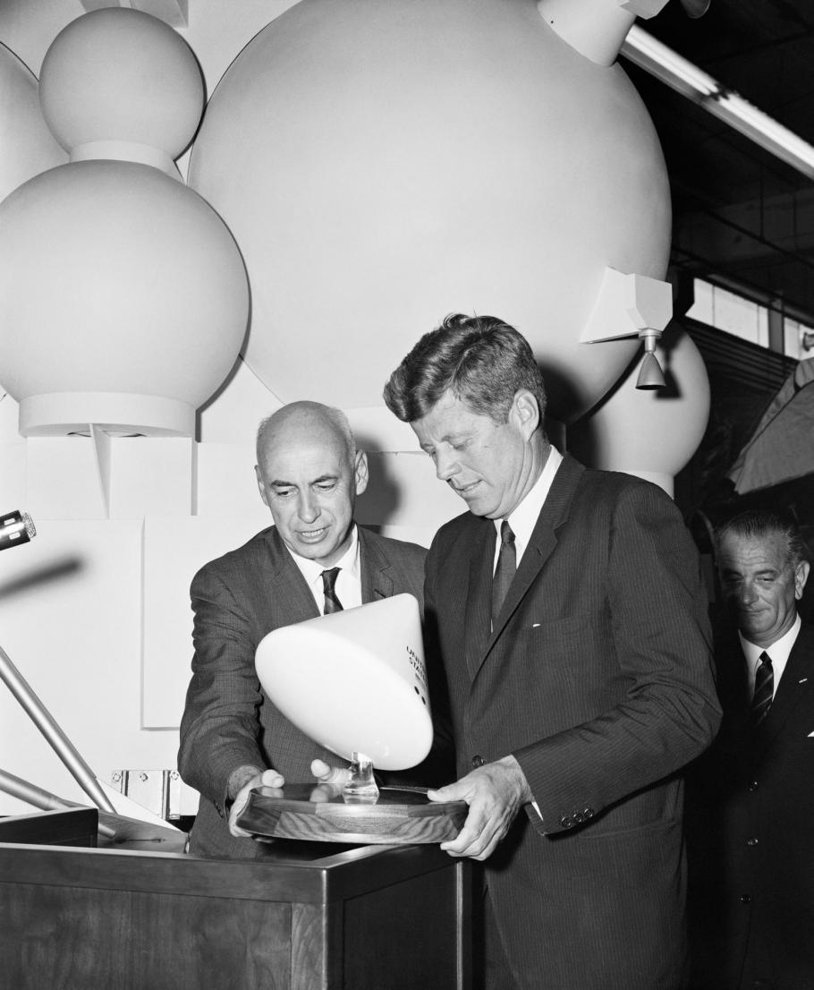 Man holding command module model with John Kennedy