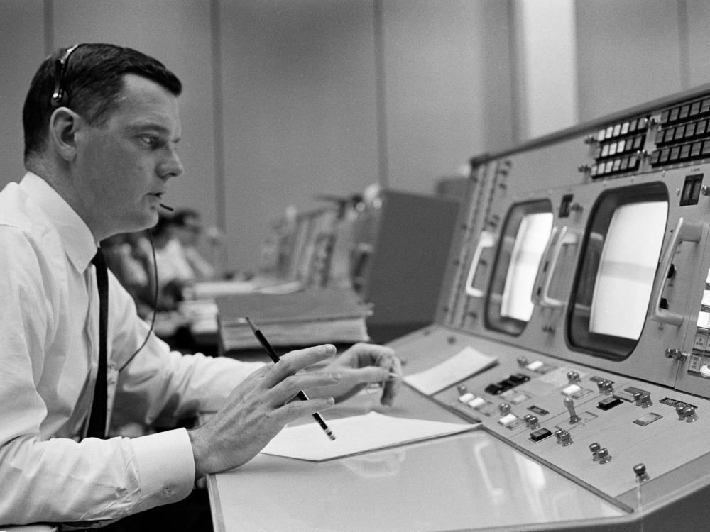 Man sitting at a flight control station