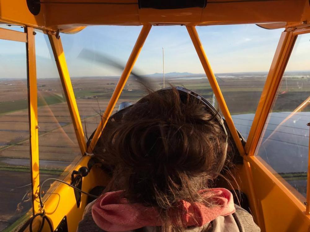 A photo of Ariel Tweto piloting an airplane