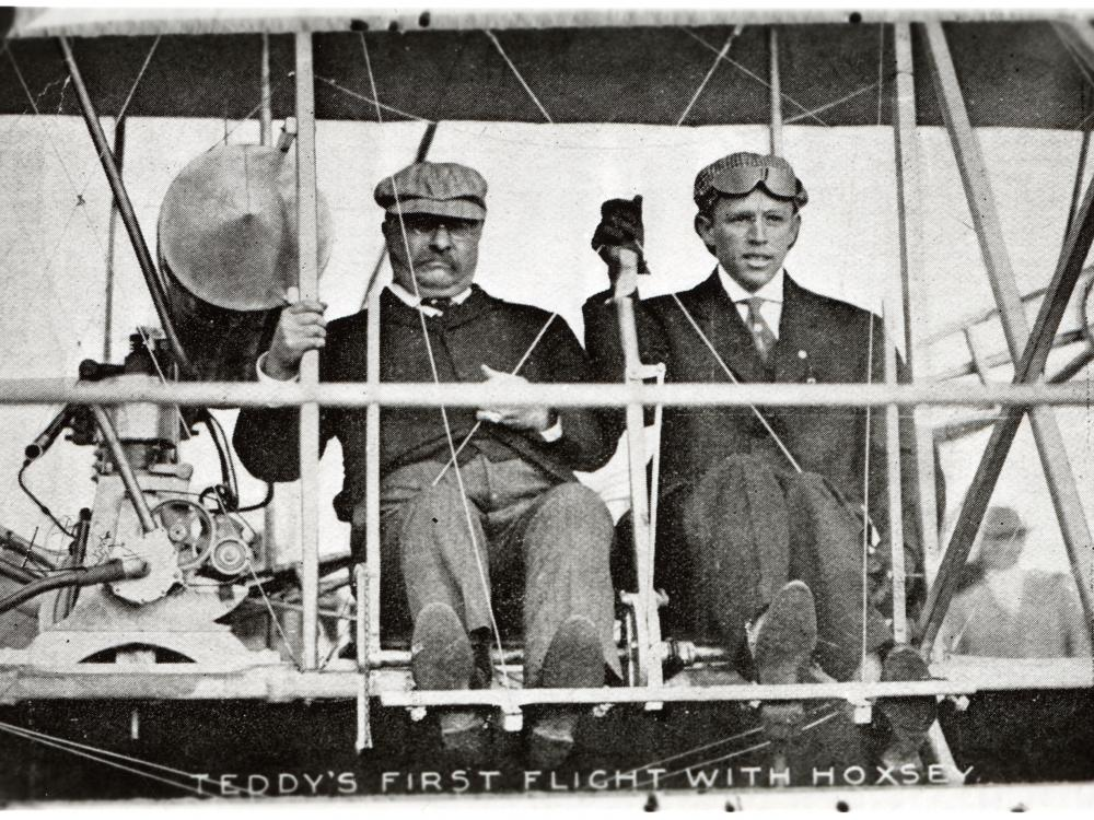 President Theodore Roosevelt (left) and pilot Arch Hoxsey (right) seated in Hoxsey's Wright (Co) Type AB.