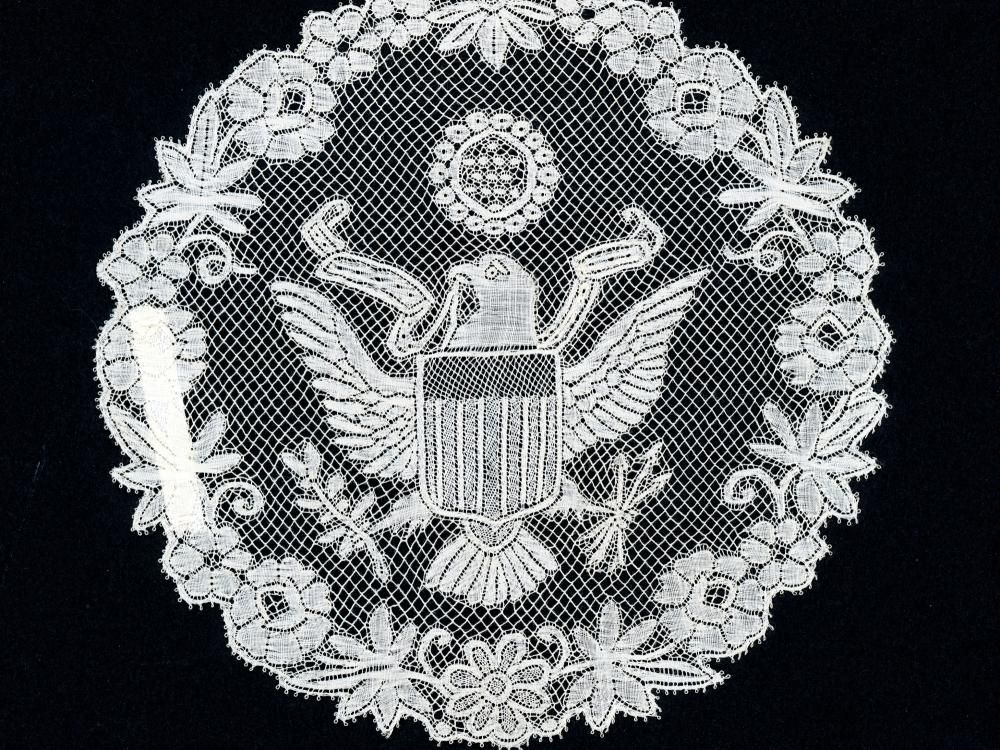 Circular lace against a black backdrop.