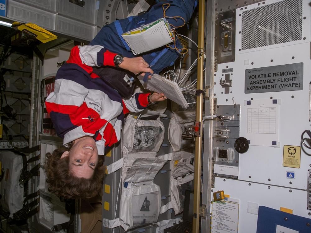 Astronaut Ellen Ochoa, STS-96 mission specialist, in the SpaceHab module aboard the Earth-orbiting Space Shuttle Discovery, 1999.