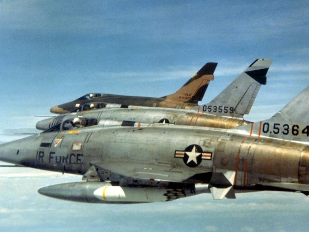 F-100Ds of the 481st Tactical Fighter Squadron over South Vietnam in February 1966. Early, unpainted F-100s are in the forerground. Camouflage painted aircraft in the back.