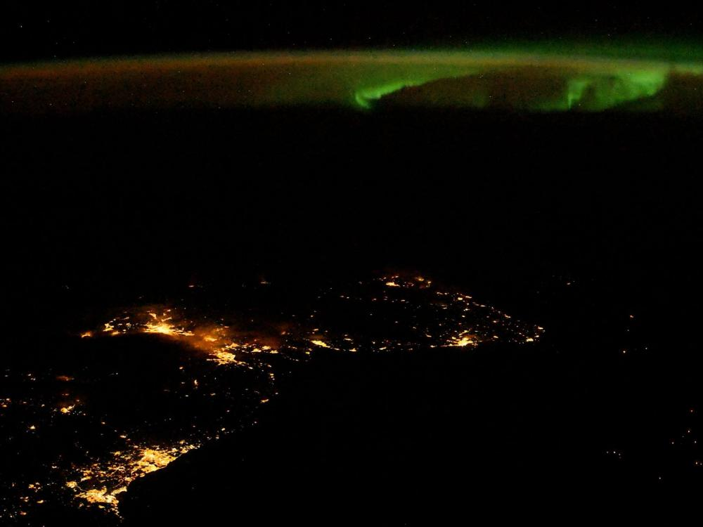 A photo of an aurora over Scotland taken by NASA astronaut Randy Bresnik aboard the International Space Station.