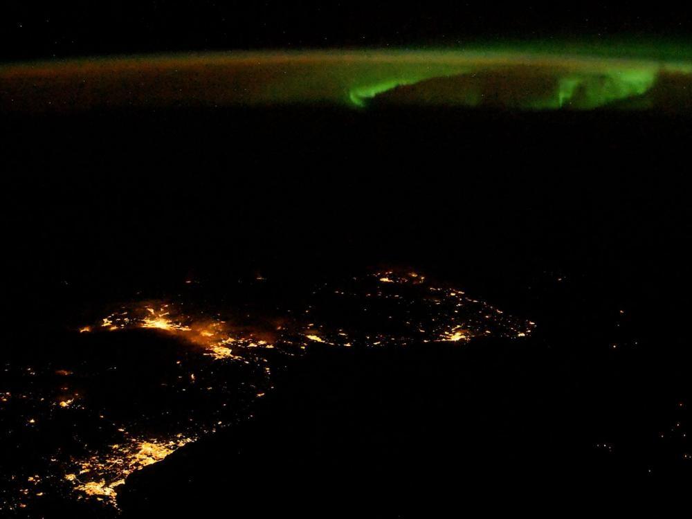 A photo of an aurora over Scotland taken by NASA astronaut Randy Bresnik aboard the International Space Station.