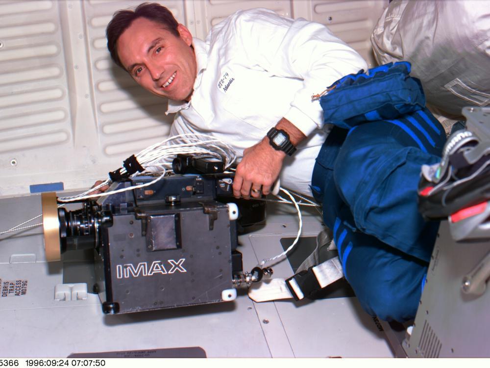 Astronaut Carl E. Walz with an IMAX Camera