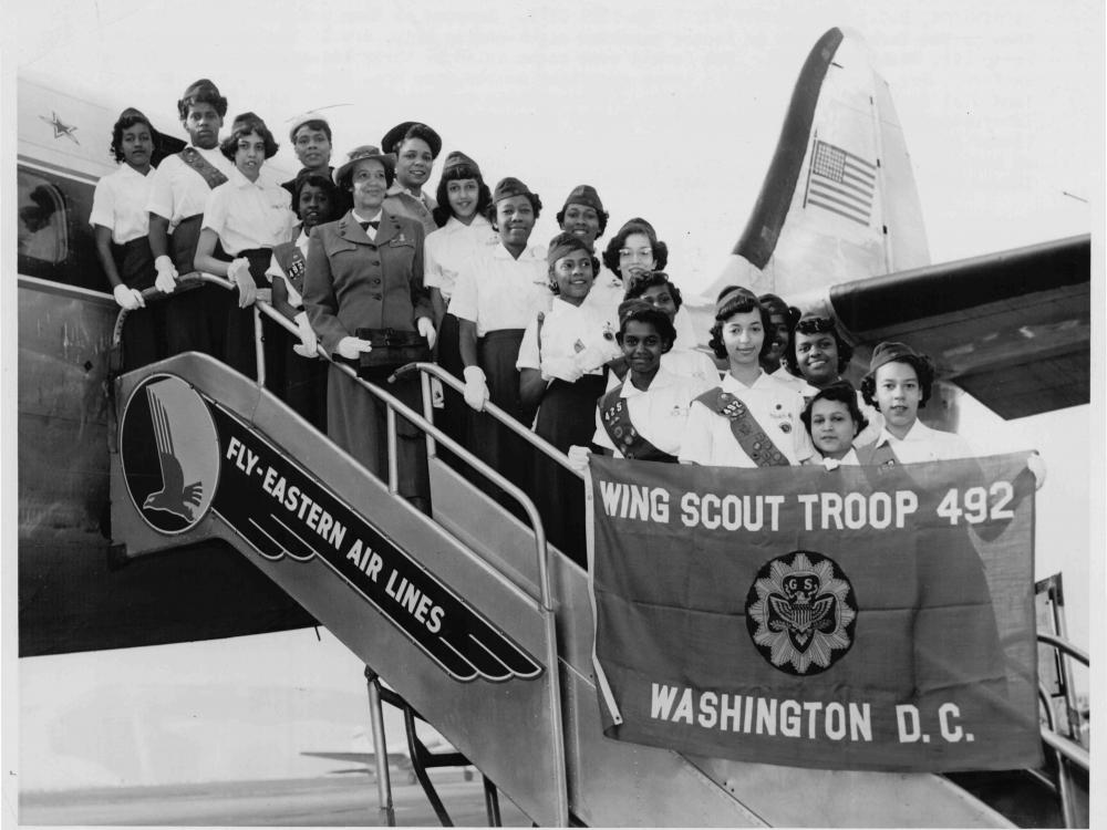 Wing Scouts Boarding Airplane