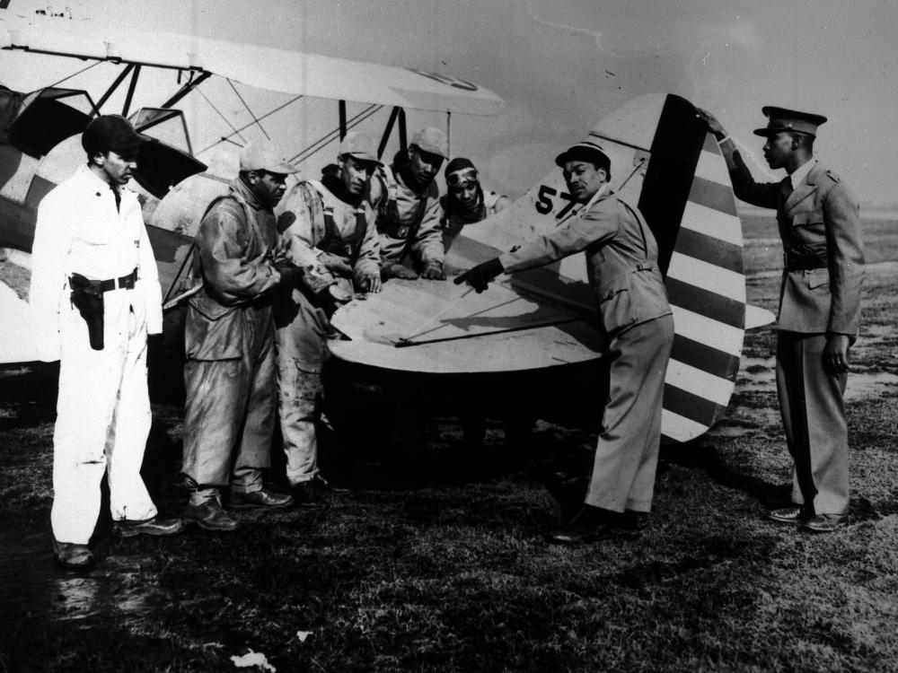 Seven men with an airplane