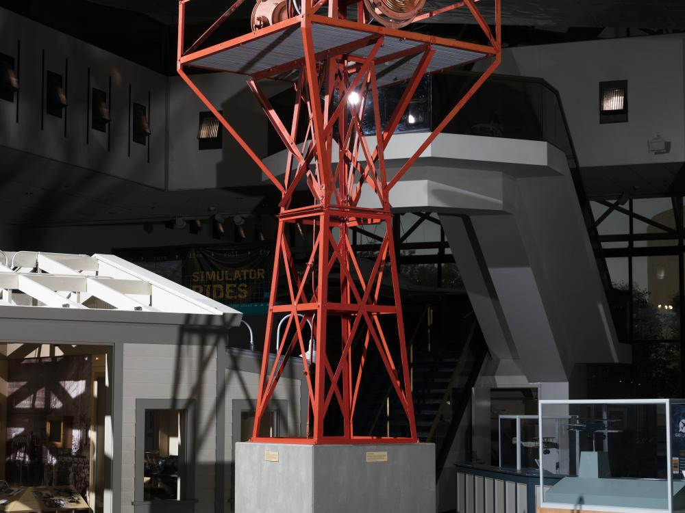 Red tower with light at top.