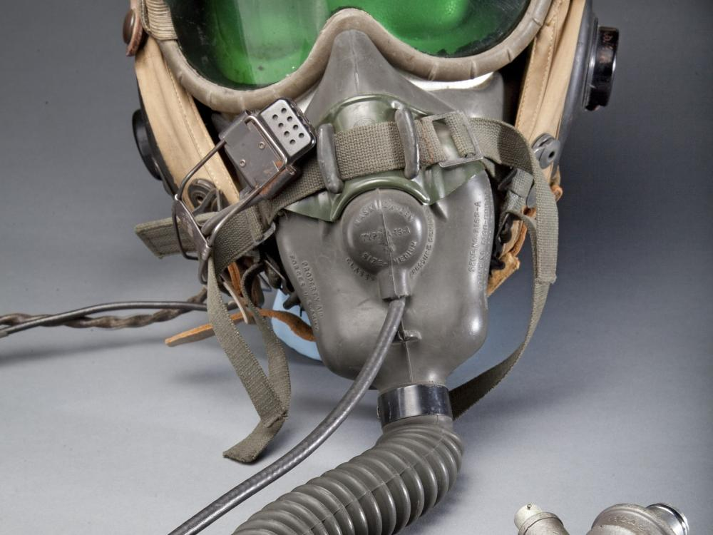A Type A-13A oxygen mask and Polaroid goggles were worn with this helmet during many flights in 1944-1946. Made by Stefan A. Cavallo, a test pilot for the National Advisory Committee for Aeronautics (NACA).