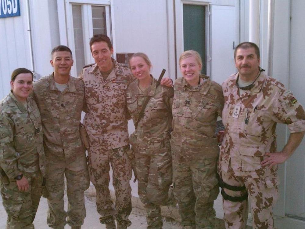 Royal Air Force Flt. Lt. Sarah Cole with her coalition peers in Afghanistan.