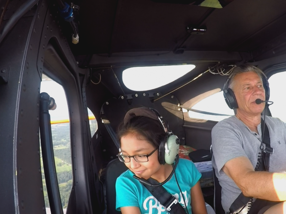 A participant in the She Can STEM summer camp learns how to pilot an airplane on a discovery flight.