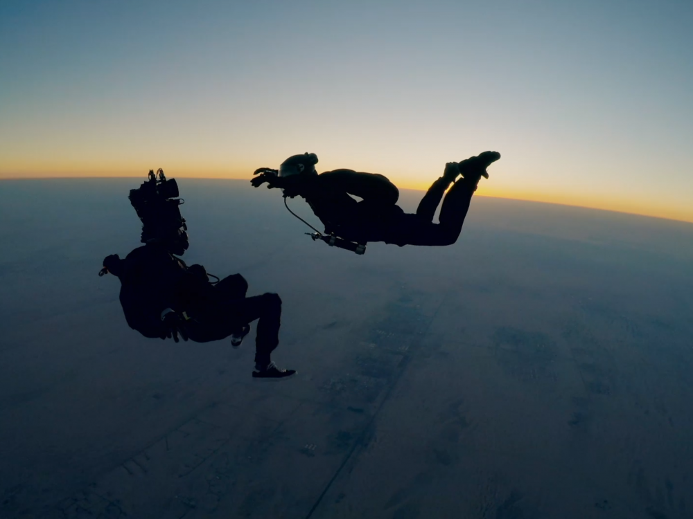 Tom Cruise filming a HALO jump scene for Mission: Impossible— Fallout.