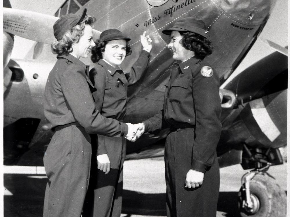 Three women in front of aircraft