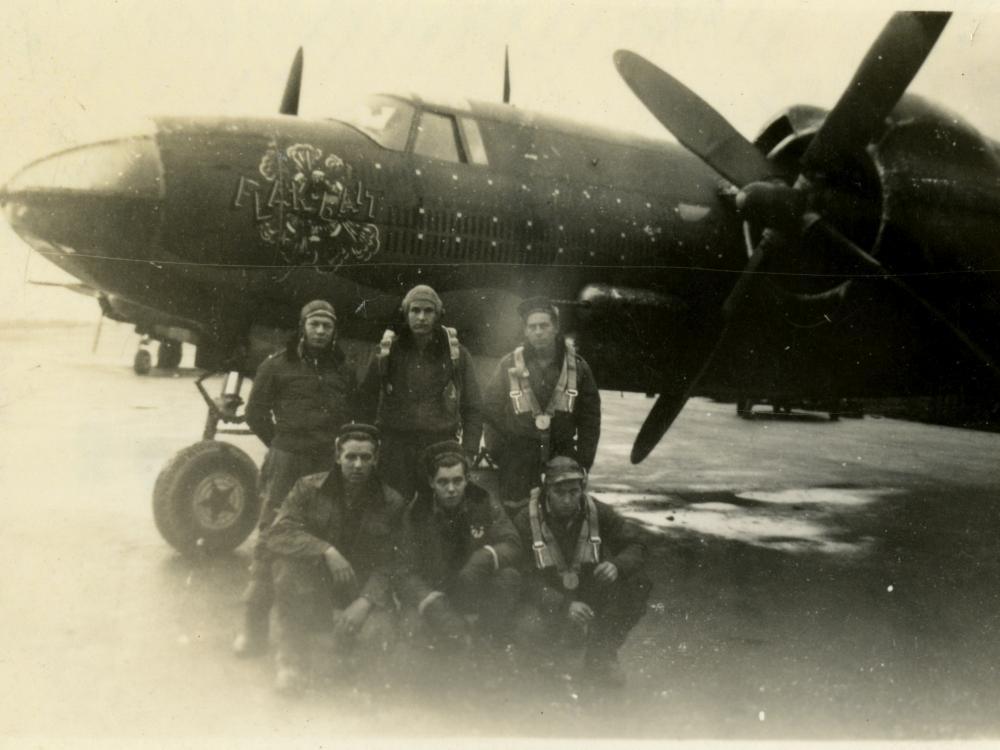 Six men in front of Flak-Bait
