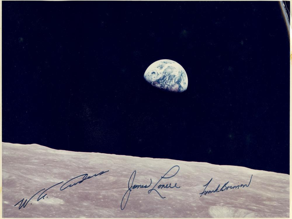 "View of the Earth rising above the lunar surface, taken from the Apollo 8 spacecraft, December 24, 1968. Autographed by William Alison Anders, Frank Frederick Borman, II, and James Arthur ""Jim"" Lovell, Jr."