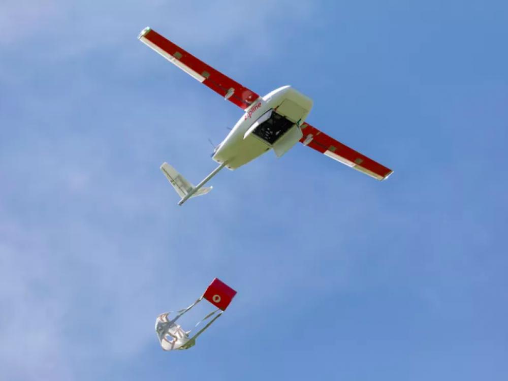 """Red """"Robin"""" Zipline drone in flight"""