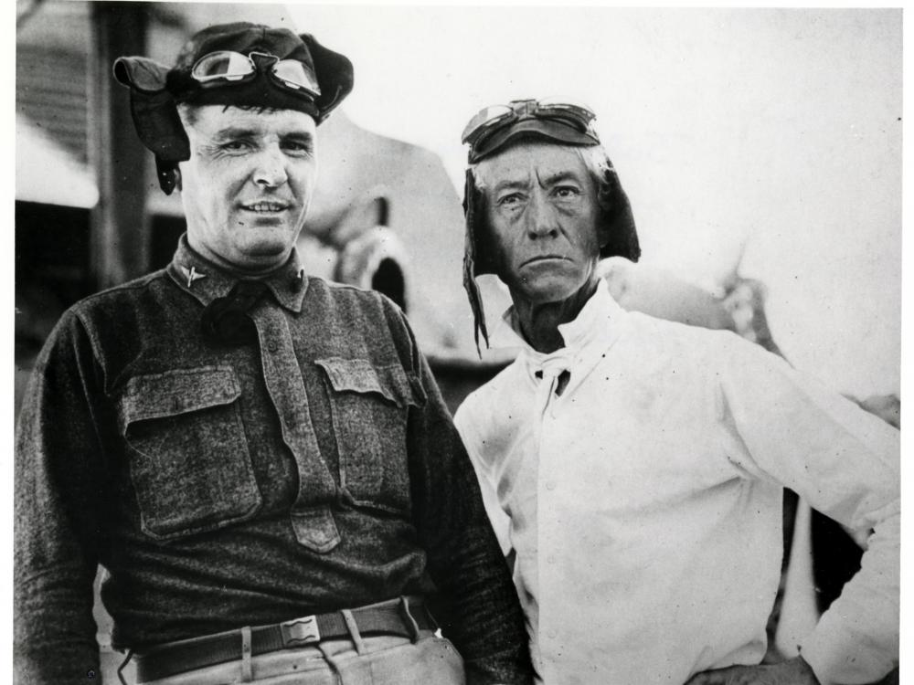 Two men in Pilots Caps and Goggles