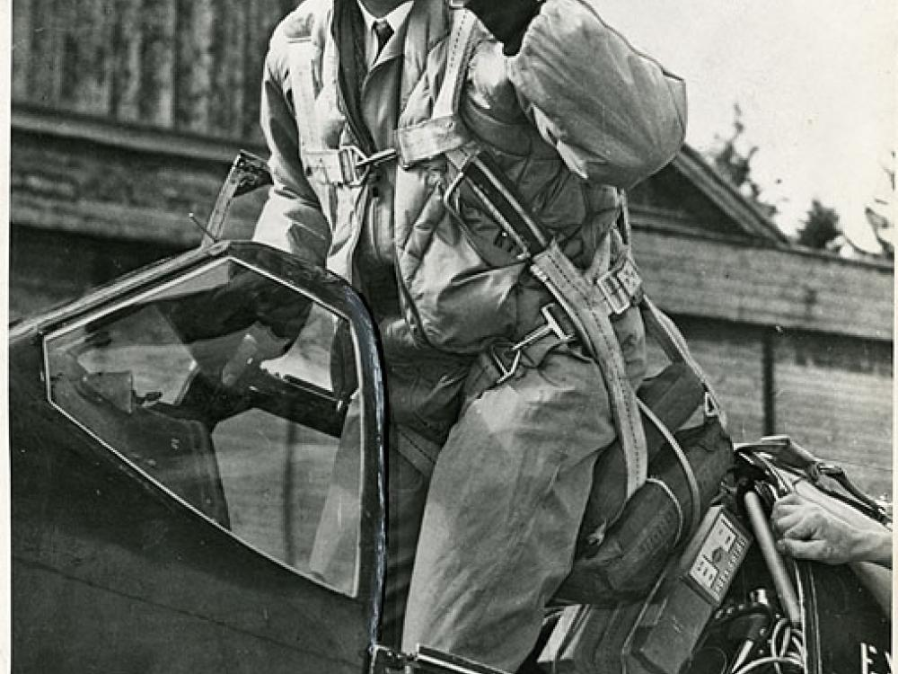 Image of Charles Blair posing in the cockpit of Excalibur III