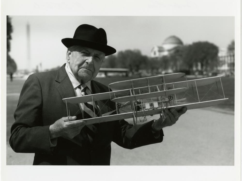 Man holding model airplane