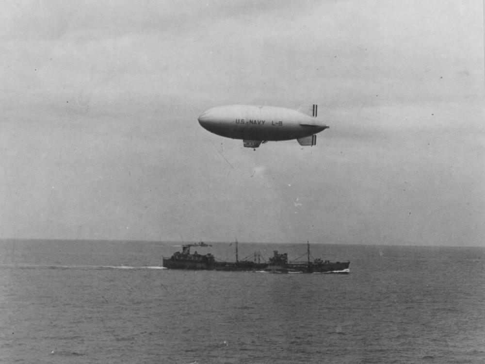 US Navy blimp L-8 in flight to drop off supplies
