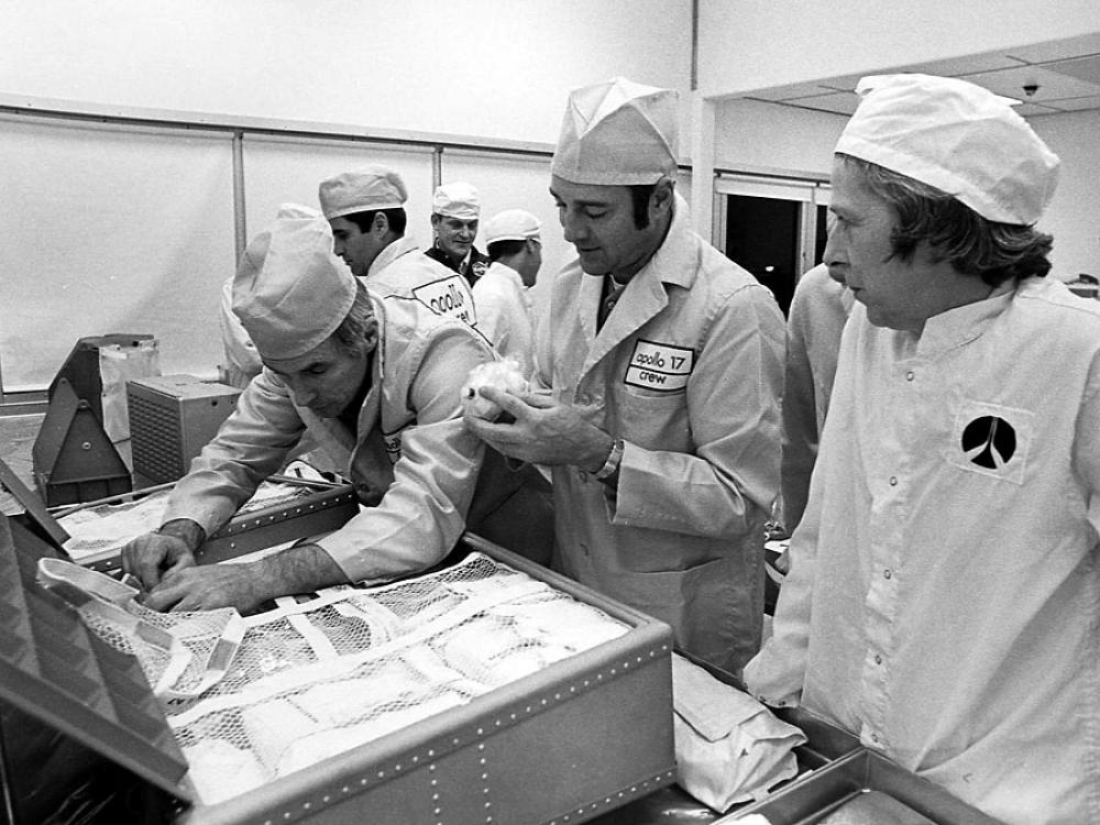 """Astronauts Ron Evans, Eugene Cernan, and Harrison """"Jack"""" Schmitt of Apollo 17 inspect food stowage with Rapp's guidance"""