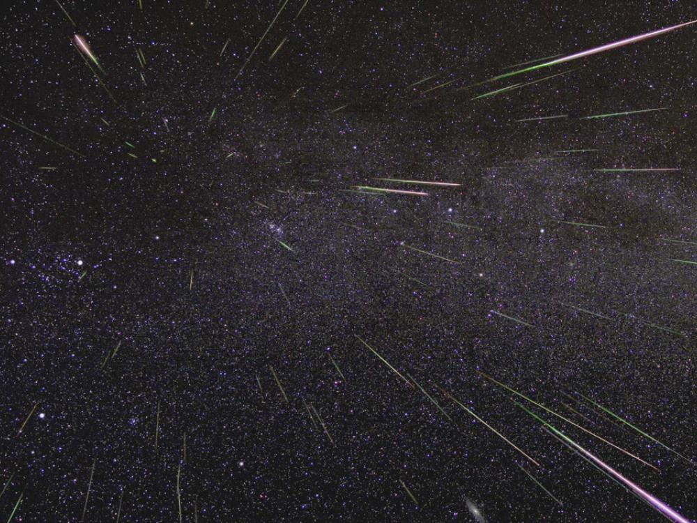 Image of the night sky wiht streaks of colorful meteors.
