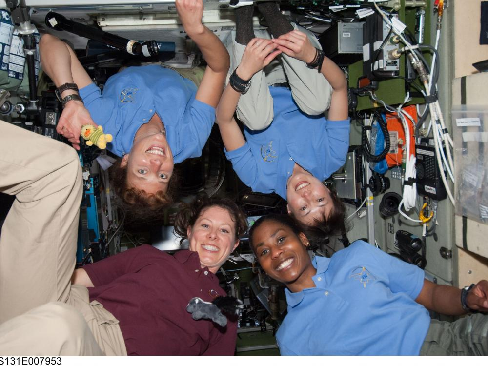 Female Astronauts Float in Space