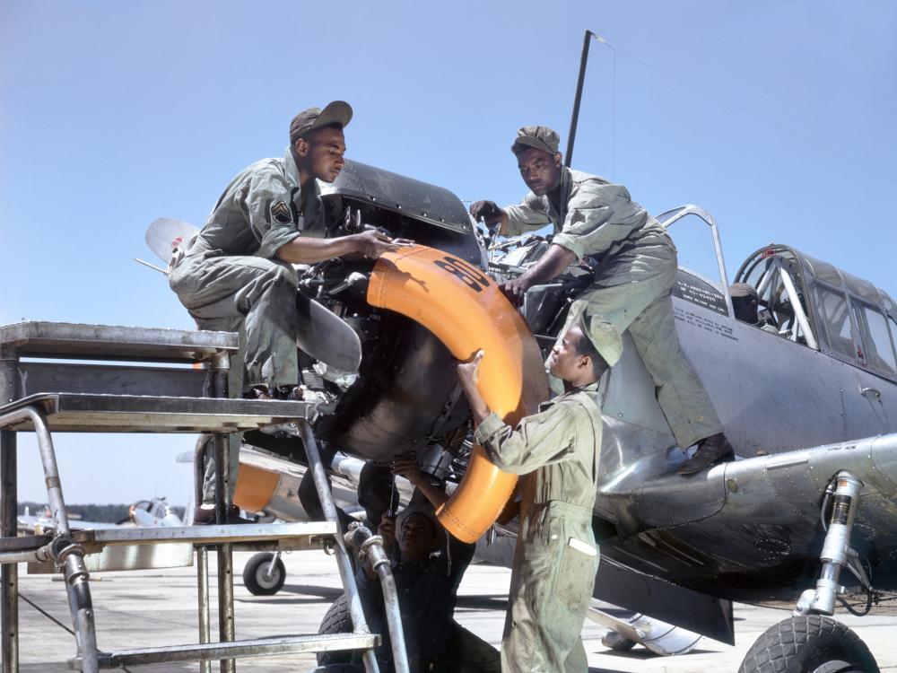 Mechanics at Tuskegee Army Air Field maintain an engine of a Vultee BT-13A Valiant