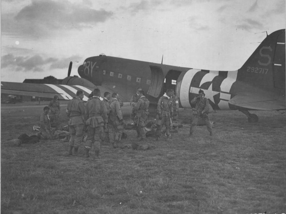 Paratroopers board a military aircraft