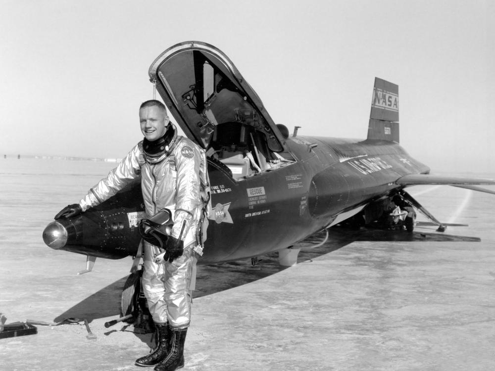 Neil Armstrong standing next to the Museum's North American X-15